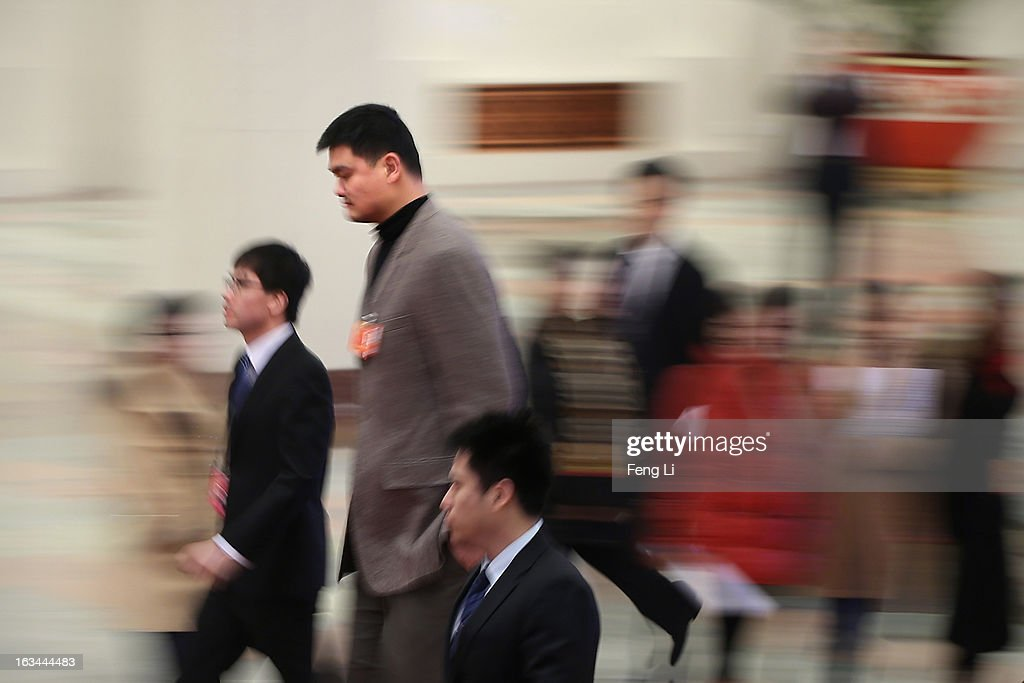 Delegate <a gi-track='captionPersonalityLinkClicked' href=/galleries/search?phrase=Yao+Ming&family=editorial&specificpeople=201476 ng-click='$event.stopPropagation()'>Yao Ming</a> (Top), a former NBA basketball star, arrives at the Great Hall of the People to attend a plenary session of the National People's Congress on March 10, 2013 in Beijing, China. The State Council, China's cabinet, will begin its seventh restructuring attempt in the past three decades to roll back red tape and reduce administrative intervention. Several departments under the State Council will be reorganized according to a plan on the institutional restructuring and functional transformation of the State Council, which was submitted to the plenary session of the National People's Congress Sunday.