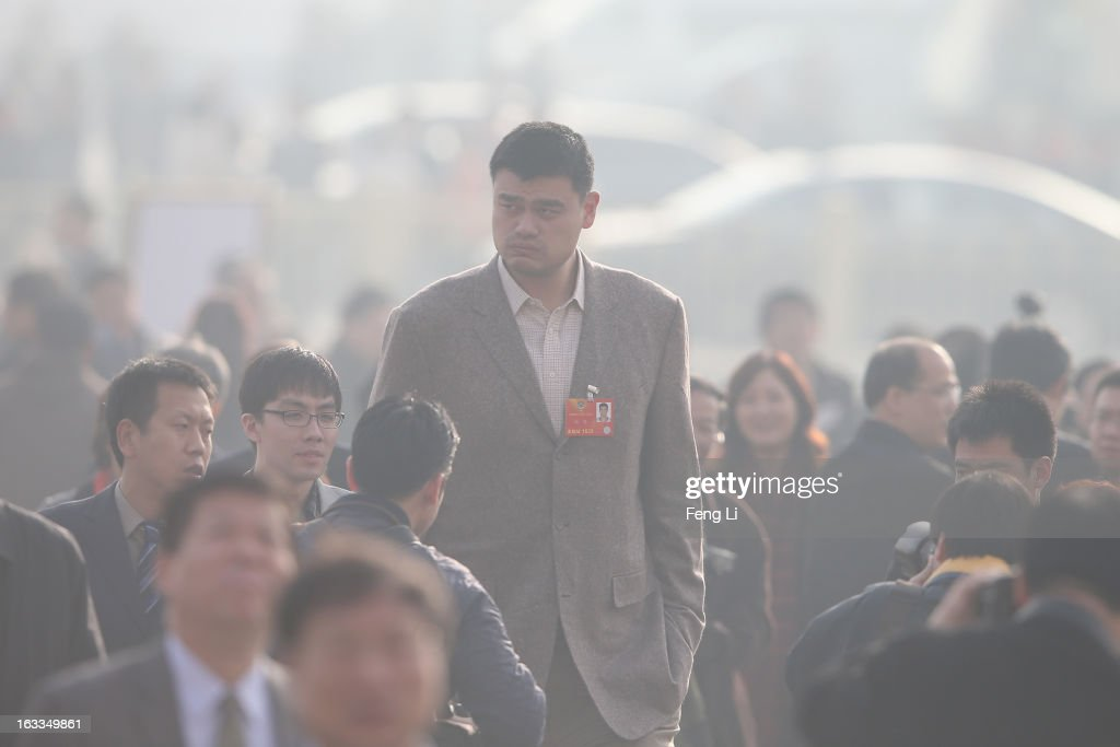 Delegate <a gi-track='captionPersonalityLinkClicked' href=/galleries/search?phrase=Yao+Ming&family=editorial&specificpeople=201476 ng-click='$event.stopPropagation()'>Yao Ming</a> (Top), a former NBA basketball star, walks from Tiananmen Square to the Great Hall of the People to attend a plenary session of the Chinese People's Political Consultative Conference during severe pollution on March 8, 2013 in Beijing, China. Clearing urban air pollution has become a big concern during the Chinese People's Political Consultative Conference.