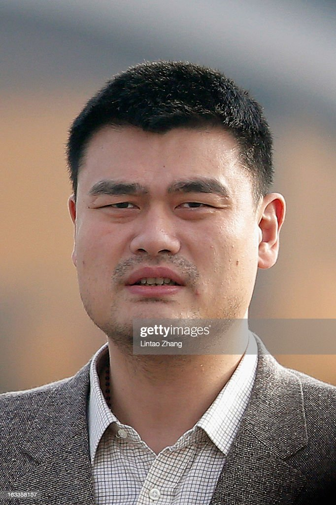 Delegate Yao Ming, a former NBA basketball star, walks from Tiananmen Square to the Great Hall of the People to attend a plenary session of the Chinese People's Political Consultative Conference during severe pollution on March 8, 2013 in Beijing, China. Urban air pollution is one of the main concerns of the Chinese People's Political Consultative Conference.