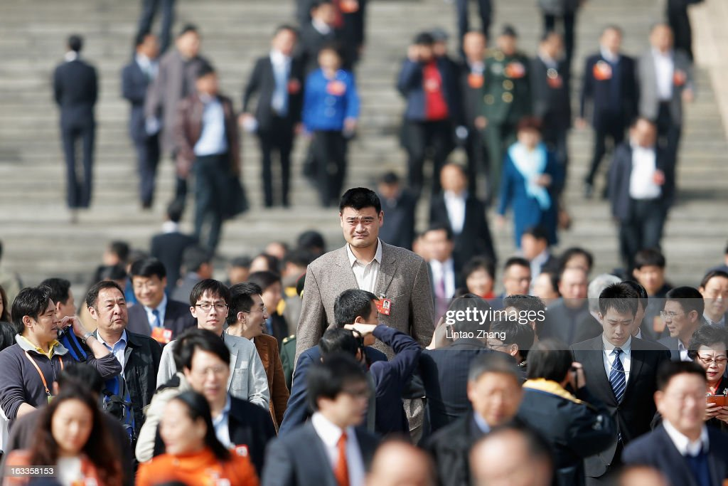 Delegate <a gi-track='captionPersonalityLinkClicked' href=/galleries/search?phrase=Yao+Ming&family=editorial&specificpeople=201476 ng-click='$event.stopPropagation()'>Yao Ming</a> (C) a former NBA basketball star, walks out of the Great Hall of the People after a plenary session of the Chinese People's Political Consultative Conference at the Great Hall of the People on March 8, 2013 in Beijing, China. Urban air pollution is one of the main concerns of the Chinese People's Political Consultative Conference. Over 2,000 members of the 12th National Committee of the Chinese People's Political Consultative, a political advisory body, are attending the annual session, during which they will discuss the development of China.