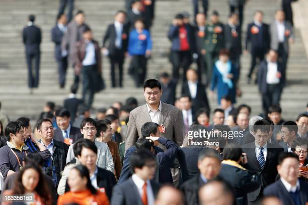 Delegate Yao Ming a former NBA basketball star walks out of the Great Hall of the People after a plenary session of the Chinese People's Political...