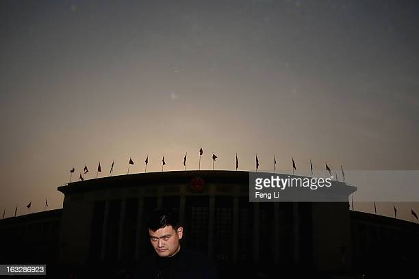 Delegate Yao Ming a former NBA basketball star walks out the Great Hall of the People after a plenary session of the Chinese People's Political...