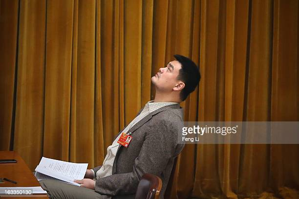 Delegate Yao Ming former NBA basketball star attends a plenary session of the Chinese People's Political Consultative Conference at the Great Hall of...