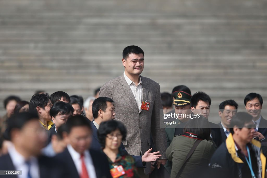 Delegate <a gi-track='captionPersonalityLinkClicked' href=/galleries/search?phrase=Yao+Ming&family=editorial&specificpeople=201476 ng-click='$event.stopPropagation()'>Yao Ming</a>, former NBA basketball star, walks out the Great Hall of the People after a plenary session of the Chinese People's Political Consultative Conference at the Great Hall of the People on March 8, 2013 in Beijing, China. Clearing urban air pollution has become a big concern during the Chinese People's Political Consultative Conference. Over 2,000 members of the 12th National Committee of the Chinese People's Political Consultative, a political advisory body, are attending the annual session, during which they will discuss the development of China.