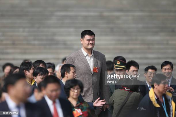 Delegate Yao Ming former NBA basketball star walks out the Great Hall of the People after a plenary session of the Chinese People's Political...