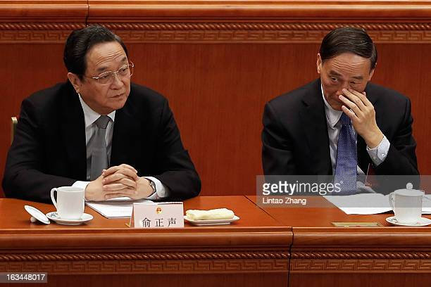 Delegate Yu Zhengsheng one of the members of new sevenseat Politburo Standing Committee and Chinese Vice Premier Wang Qishan attend the Third Plenary...