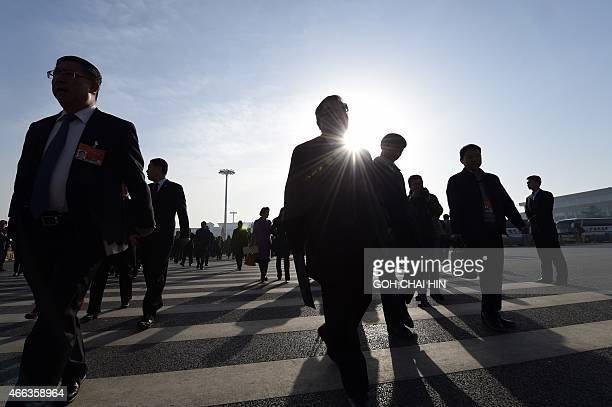 Delegates arrive for the closing of the 3rd Session of the 12th National People's Congress out of the Great Hall of the People in Beijing on March 15...