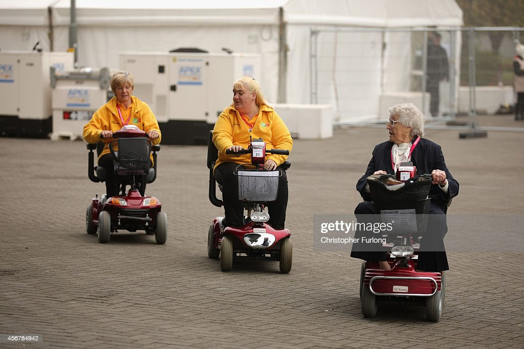 Delegates arrive for the fourth day of the Liberal Democrat Autumn conference at the SECC on October 7, 2014 in Glasgow, Scotland. Lib Dem Energy Secretary Ed Davey will later address delgates where he is expected to announce a U-turn on the party's stance on airport expansion.