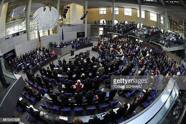 Delegates attend a minute of silence for late member of parliament Philipp Missfelder prior to a special session at the Bundestag in Berlin on July...