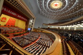 Delegates attend the closing ceremony of the Chinese National People's Congress at the Great Hall of the People in Beijing on March 13 2014 China's...