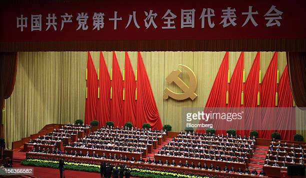 Delegates attend the closing session of the 18th National Congress of the Communist Party of China at the Great Hall of the People in Beijing China...
