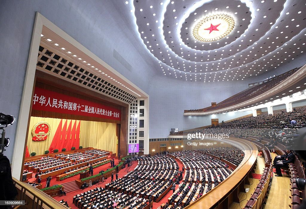 Delegates attend the closing session of the National People's Congress (NPC) at the Great Hall of the People on March 17, 2013 in Beijing, China. China's newly-elected president Xi Jinping pledged Sunday to resolutely fight against corruption and other misconduct in all manifestations.