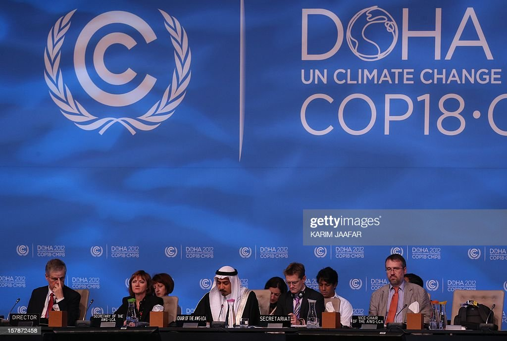 Delegates attend the last day of the UN climate talks in Doha, on December 7, 2012. UN climate negotiators locked horns on the final day of talks in Doha to halt the march of global warming, deeply divided on extending the greenhouse gas-curbing Kyoto Protocol and funding for poor countries.