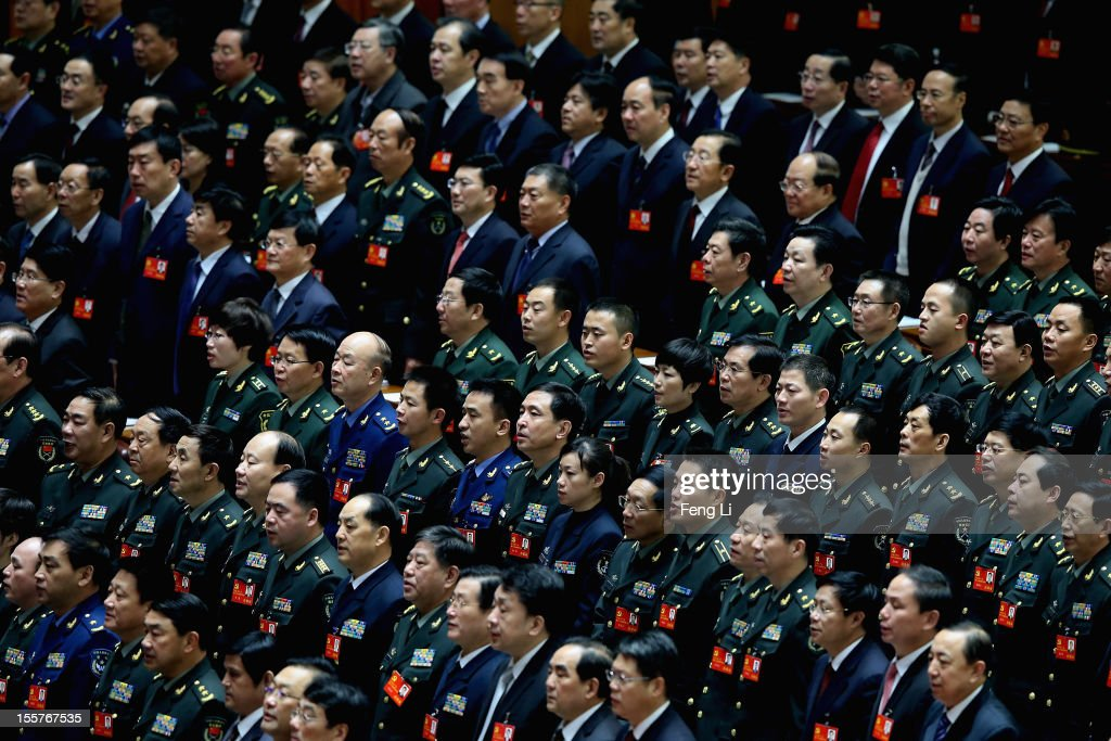 Delegates attend the opening session of the 18th Communist Party Congress held at the Great Hall of the People on November 8, 2012 in Beijing, China. The Communist Party Congress will convene from November 8-14 and will determine the party's next leaders.