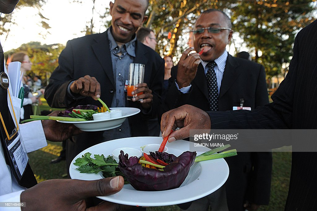 Delegates attending the Governing Council of the United Nations Environment Programme (UNEP) taste rejected green salad grown by Kenyan farmers but rejected by UK supermarkets due to cosmetic imperfections, at the UN headquarters in Nairobi on February 19, 2013. The campaign aims to promote actions by consumers and food retailers to dramatically cut the 1.3 billion tonnes of food lost or wasted each year-which aside from the cost implications and environmental impacts increases pressure on the already straining global food system – and help shape a sustainable future.
