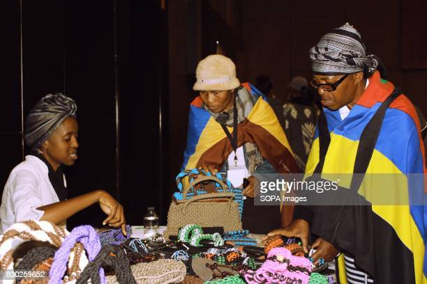 Delegates buying some of the products produced by women founded cooperatives being exhibited at the Annual 2nd International Women Entrepreneur...