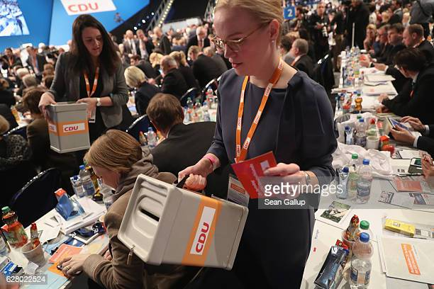 Delegates cast their ballots over whether to reelect German Chancellor and Chairwoman of the German Christian Democrats Angela Merkel as party...