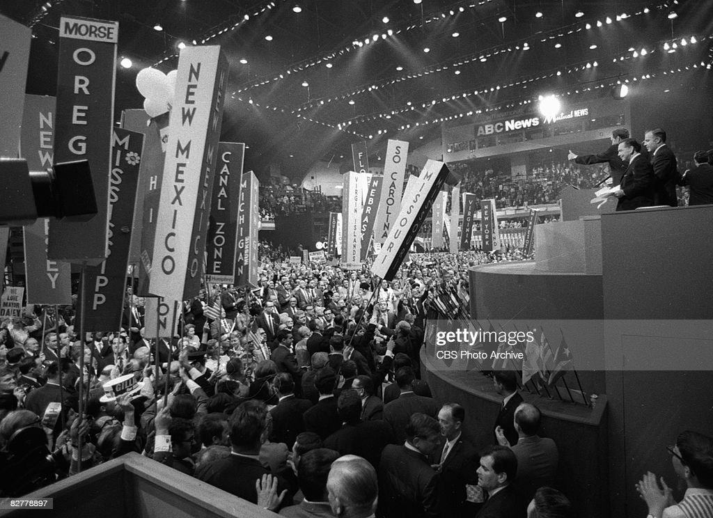 Delegates crowd around the stage on the floor of the Democratic National Convention in the International Amphitheatre Chicago Illinois August 29 1968...