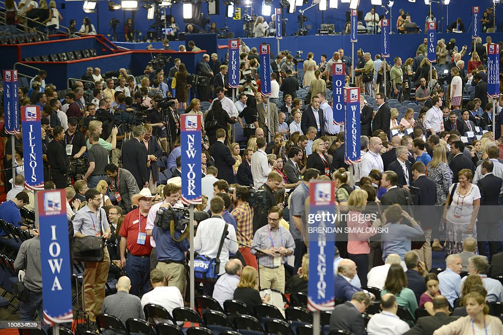 Delegates crowd the floor while waiting for the Chairman of the Republican National Convention Reince Priebus to gavel the convention to order at the...