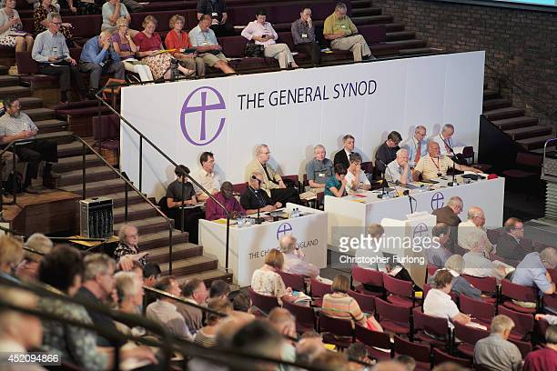 Delegates discuss issues during the afternoon session of the annual Church of England General Synod at York University on July 13 2014 in York...