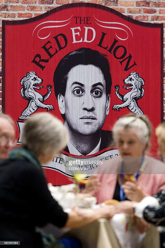 Delegates enjoy afternoon tea near to a spoof Ed Miliband-themed 'pub' on the first day of the Conservative Party Conference in Manchester on September 29, 2013. British Prime Minister David Cameron said the austerity drive pursued by his government was 'beginning to pay off' after his Conservative party announced two potentially crowd-pleasing measures ahead of its annual conference.