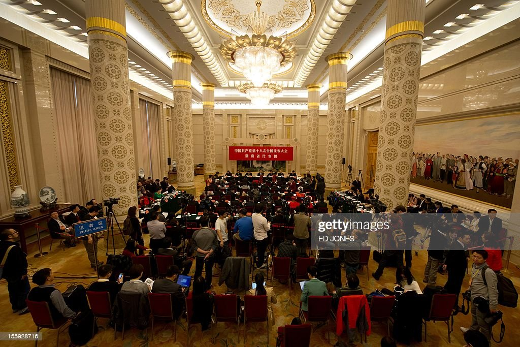 Delegates from China's Hunan province hold a meeting in the Hunan room at the Great Hall of the People in Beijing on November 9 2012 The weeklong...