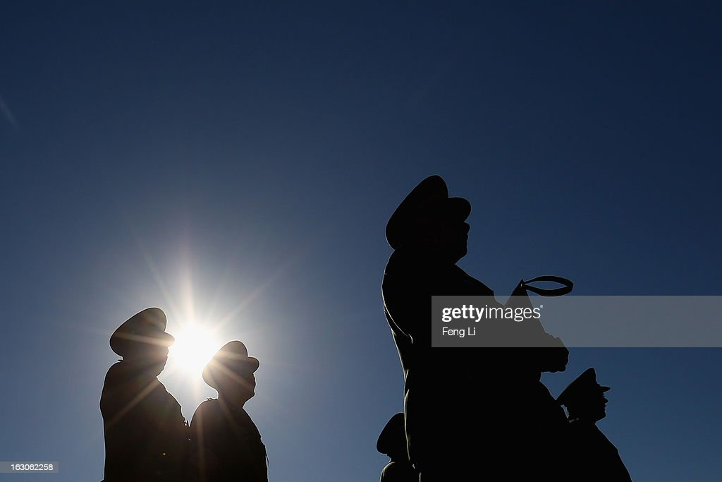 Delegates from Chinese People's Liberation Army march from Tiananmen Square to the Great Hall of the People to attend a pre-opening session of the National People's Congress (NPC), China's parliament, on March 4, 2013 in Beijing, China. China's defensive military policies have played a core role in maintaining peace and stability in Asia, a spokesperson for the annual session of China's national legislature said Monday.