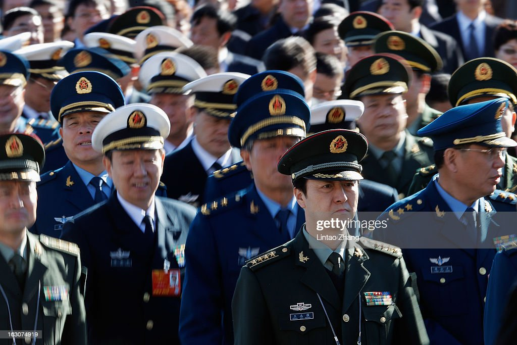 Delegates from Chinese People's Liberation Army march from Tiananmen Square to the Great Hall of the People to attend a pre-opening session of the National People's Congress (NPC), China's parliament, on March 4, 2013 in Beijing, China. Over 2,000 members of the 12th National Committee of the Chinese People's Political Consultative, a political advisory body, are attending the annual session, during which they will discuss the development of China.