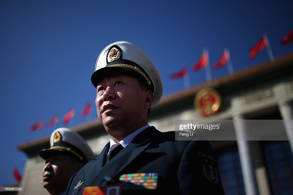 Delegates from Chinese People's Liberation Army walk out the Great Hall of the People after attending a pre-opening session of the National People's Congress, China's parliament, on March 4, 2013 in Beijing, China. China's defensive military policies have played a core role in maintaining peace and stability in Asia, a spokesperson for the annual session of China's national legislature said Monday.
