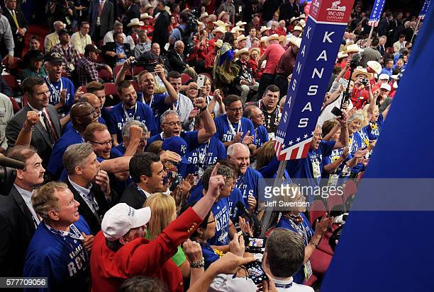 Delegates from Kansas take part in the roll call in support of presumptive Republican presidential candidate Donald Trump on the second day of the...