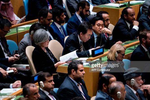 Delegates from South Korea listen while US President Donald Trump addresses the 72nd session of the United Nations General Assembly September 19 2017...