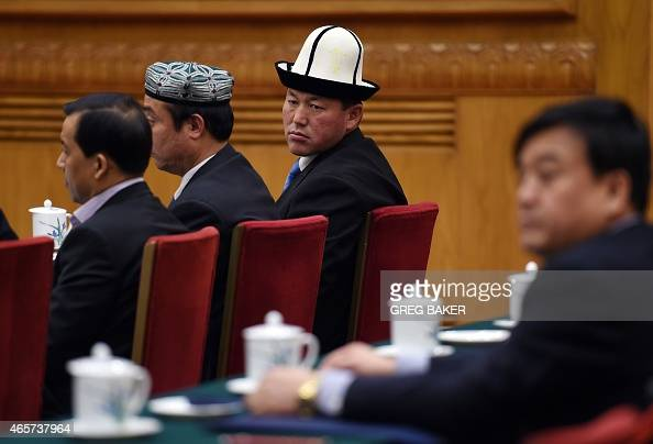 Delegates from Xinjiang take part in the Xinjiang group meeting during the ongoing annual session of China's legislature the National People's...
