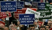 Delegates hold signs on the first day of the Republican National Convention on July 18 2016 at the Quicken Loans Arena in Cleveland Ohio The...