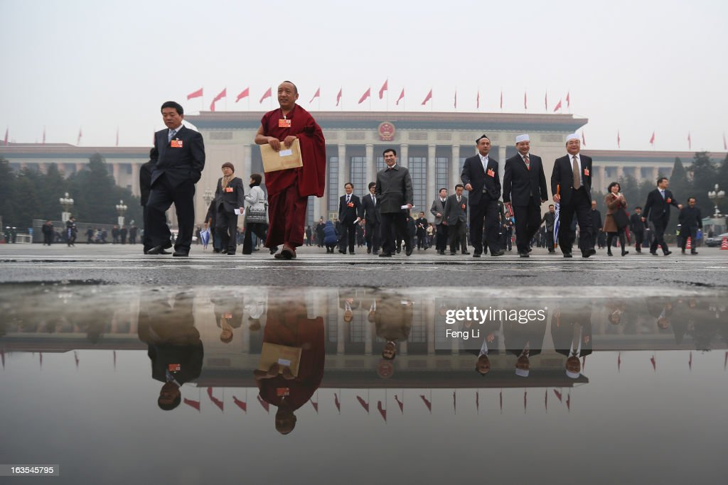 Delegates leave the Great Hall of the People after attending the closing session of the annual Chinese People's Political Consultative Conference (CPPCC) on March 12, 2013 in Beijing, China. The newly-elected Chairman of the CPPCC Yu Zhengsheng pledged Tuesday that China will not copy Western political systems under any circumstances.