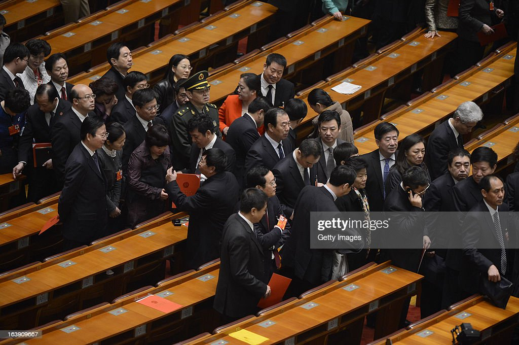 Delegates leave the Great Hall of the People after the closing session of the National People's Congress (NPC) on March 17, 2013 in Beijing, China. China's newly-elected president Xi Jinping pledged Sunday to resolutely fight against corruption and other misconduct in all manifestations.