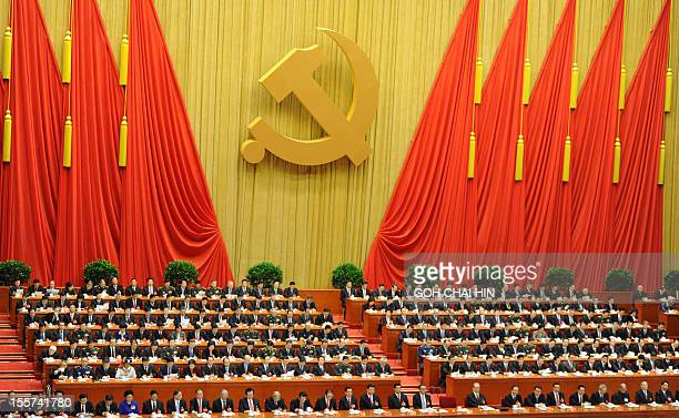 Delegates listen as Chinese President Hu Jintao delivers his address at the opening of the 18th Communist Party Congress at the Great Hall of the...