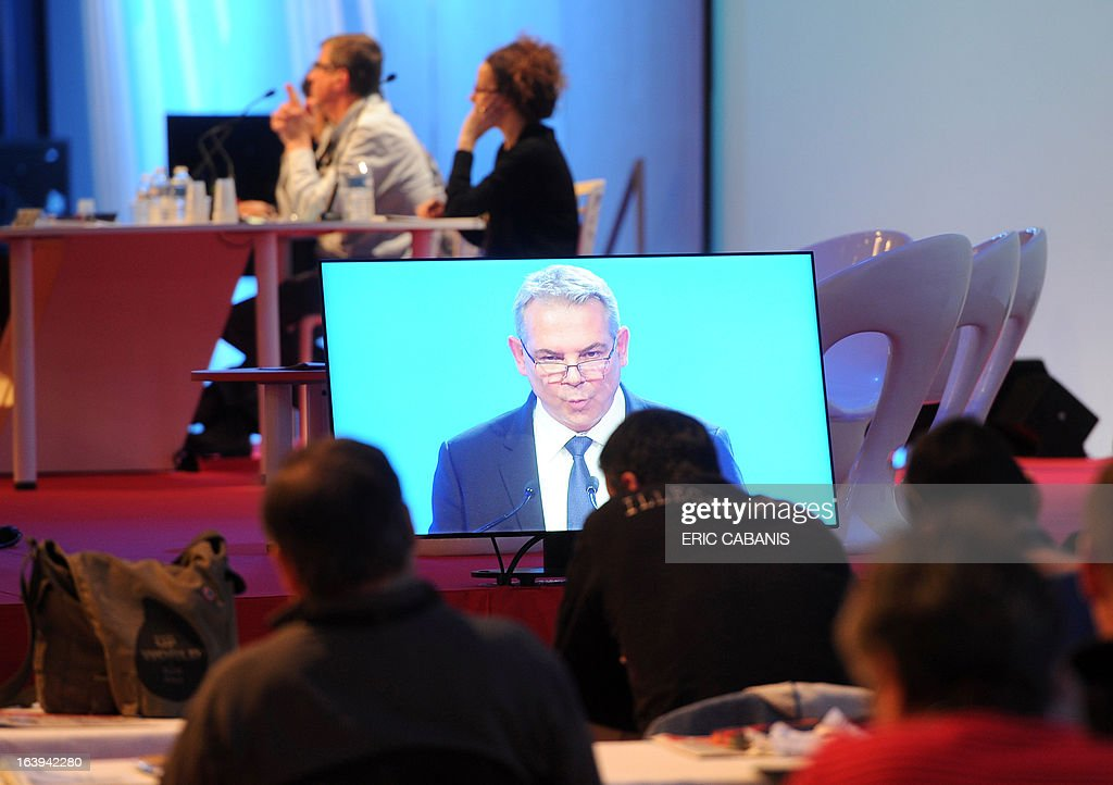 Delegates listen as French major union CGT's newly designated general secretary Thierry Lepaon (on screen) opens the CGT's 50th congress on March 18, 2013 at Toulouse's exhibition center. AFP PHOTO / ERIC CABANIS