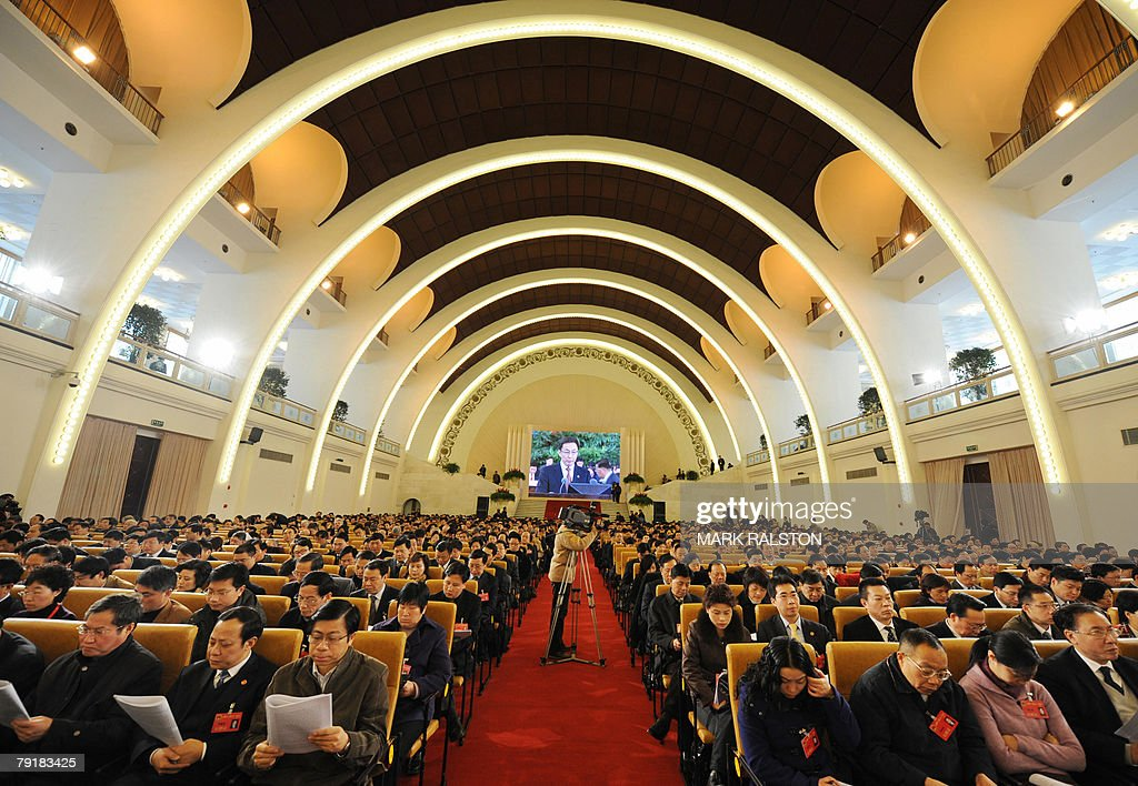 Delegates listen as Shanghai mayor Han Zheng delivers his annual work report to the 13th Shanghai Municipal People Congress at the Russian built exhibition centre in Shanghai, 24 January 2008. The annual meeting of the Shanghai legislature, meets to chart the political and economic course of China's main financial centre. AFP PHOTO/Mark RALSTON