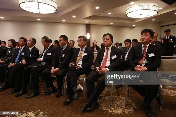 Delegates listen to California Gov Jerry Brown and Communist Party Secretary Wang Dongming of Sichuan province China as they lead a forum for US and...