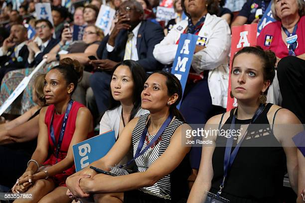 Delegates listen to former US President Bill Clinton deliver remarks on the second day of the Democratic National Convention at the Wells Fargo...