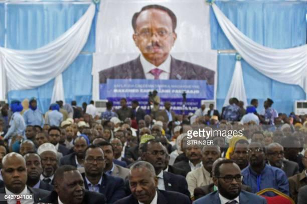Delegates listen to Somalia's new President Mohamed Abdullahi Mohamed during his inauguration at Mogadishu airport on February 22 2017 Somalia's...