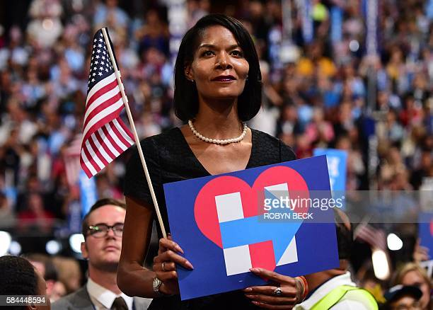 A delegates looks on as Presidential nominee Hillary Clinton speaks during the fourth and final day of the Democratic National Convention on July 28...