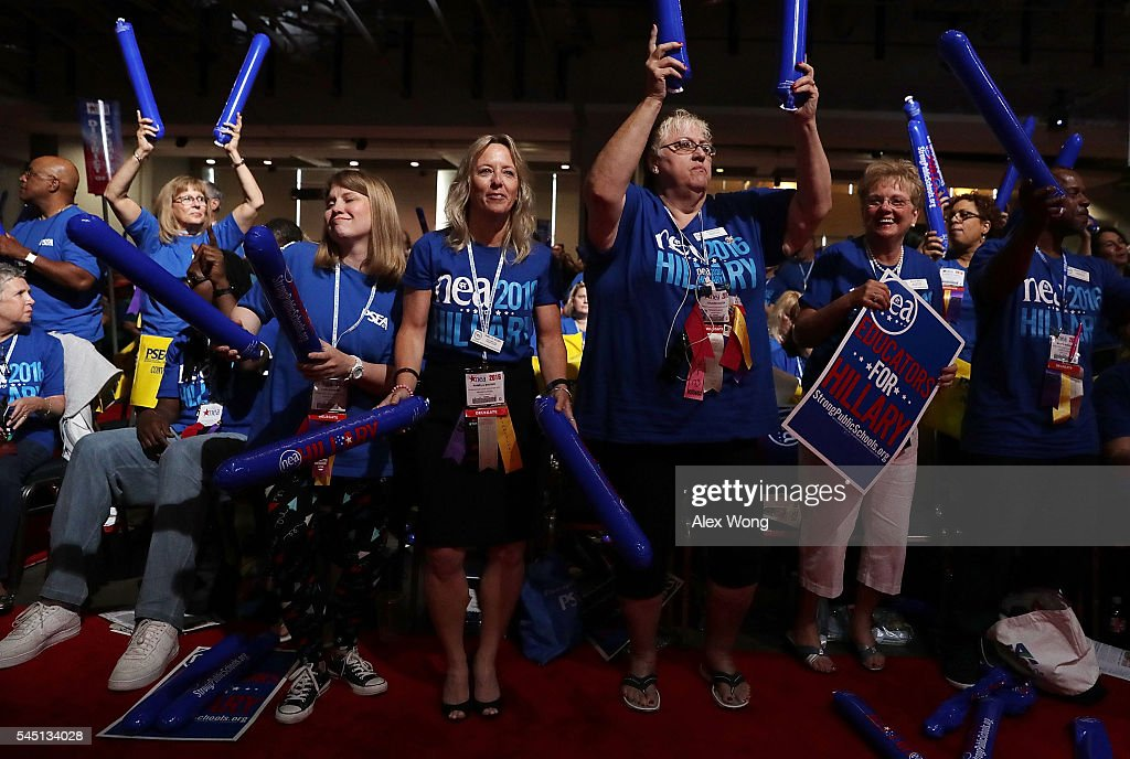 Delegates make noise with thundersticks as they wait for Democratic presidential candidate Hillary Rodham Clinton to address the 95th Representative Assembly of the National Education Association July 5, 2016 in Washington, DC. Clinton will be joined by President Barack Obama at a campaign stop in Charlotte, North Carolina later today.