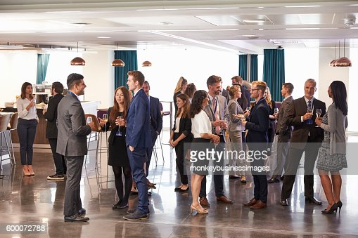 Delegates Networking At Conference Drinks Reception : Stock Photo