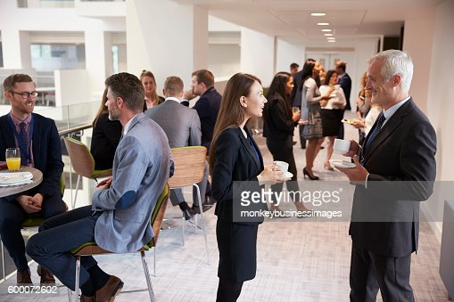 Delegates Networking During Coffee Break At Conference : Stock Photo