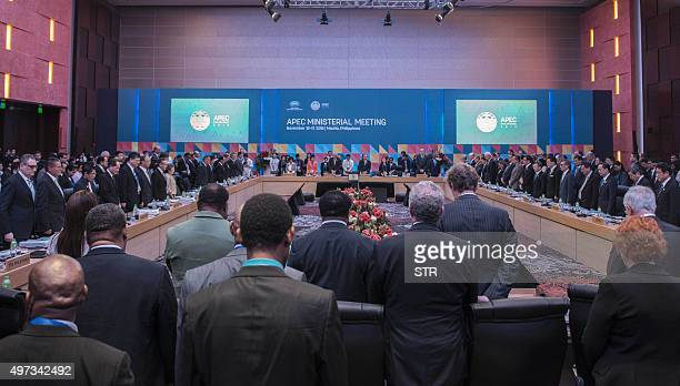 Delegates observe a minute of silence for the Paris attacks victims during the AsiaPacific Economic Cooperation Ministerial Meeting in Manila on...