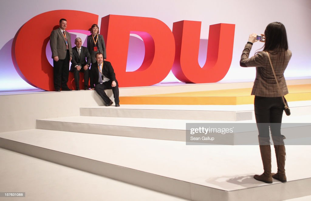 Delegates of the German Christian Democratic Union photograph one another at the CDU logo at the conclusion of the CDU federal party convention on...