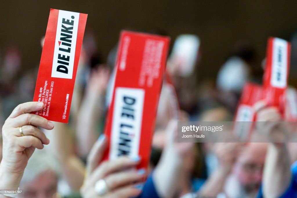 Delegates of the German leftwingparty Die Linke vote during the party's federal convention on June 15 2013 in Dresden Germany Die Linke Germany's...
