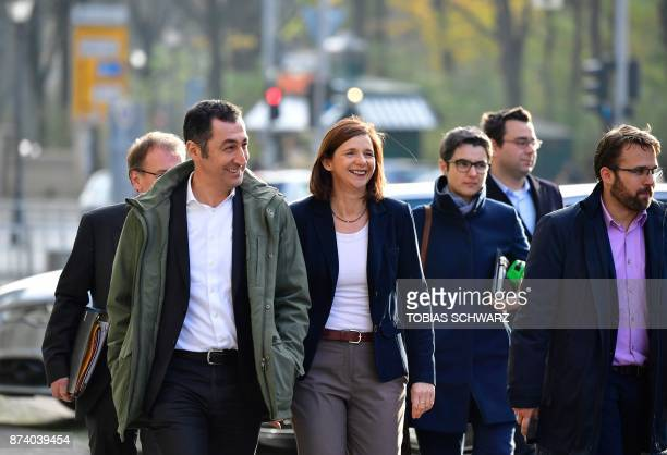 Delegates of the Greens party including coleader Cem Oezdemir and parliamentary group coleader Katrin GoeringEckardt arrive for further exploratory...