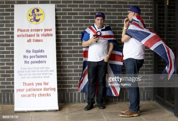 Delegates of UK Independence Party wear Union Jack during the party's annual conference at the Riviera International Conference Centre in Torquay...